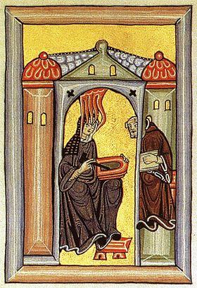 Hildegard Bingeniläinen välittää taivaalliset näkynsä kirjurille (kuva Hildegardin Scivias-teoksesta)